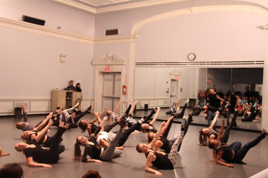 Dancers take class from renowned college dance department faculty members.