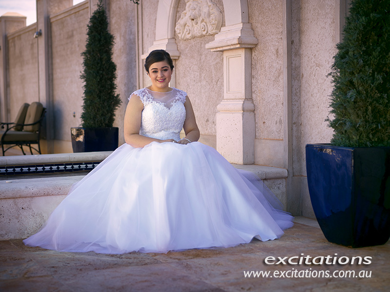 Nadia, Mildura debutante sitted in courtyard during her excitations photo shoot.
