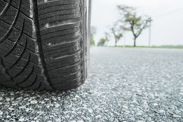 Car tire on road, close up