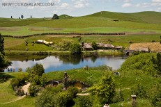 Hobbiton, Sam's home in front with Green Dragon in the background. New Zealand