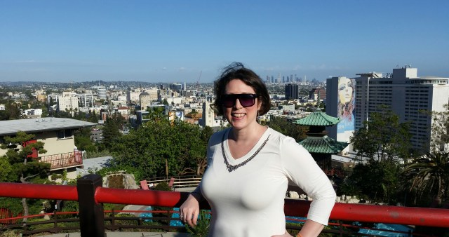 All smiles at Yamashiro Restaurant with a panoramic view of LA behind me