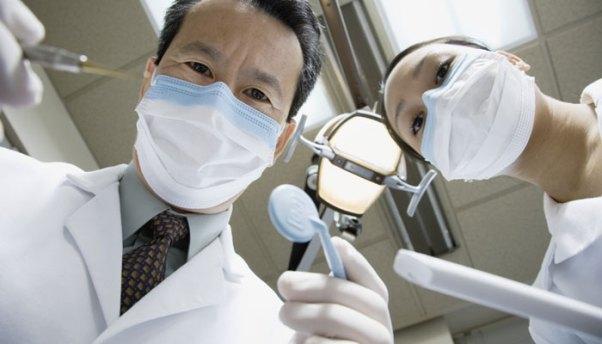 Răng sau khi bọc sứ bị nhức