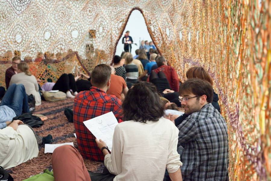people in Ernesto Neto's nest