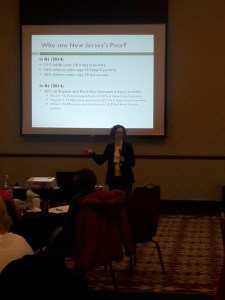 Jennifer Rosen Valverde presented on the social determinants of health, especially poverty.