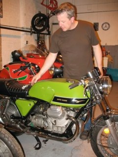 stephen checking out moto guzzi 240x320 My cousin Stephen Pate opens Italian motorcycle shop in Windy City photo