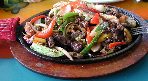 Fajitas Bravas, a combination of chicken and beef served with grilled vegetables.