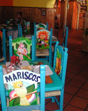 Colorful tables and chairs at Mariscos Costa Azul