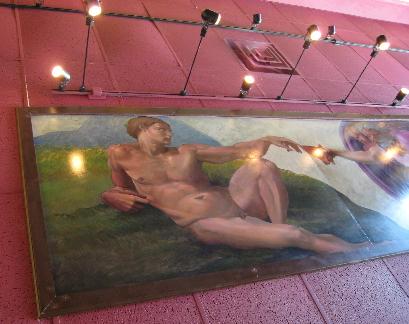 The Creation of Adam festoons the ceiling