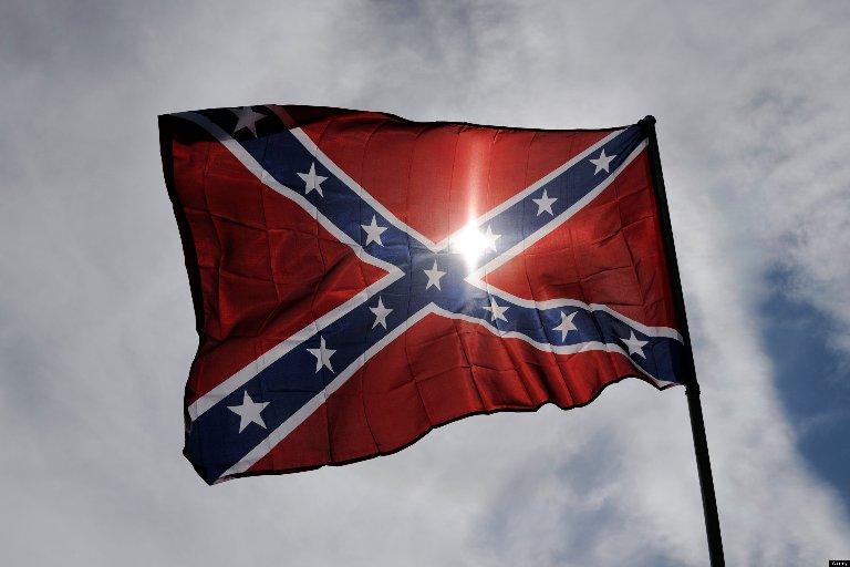 """the confederate flag essay The confederate flag's defenders often claim it represents """"heritage not hate"""" i agree—the heritage of white supremacy was not so much birthed by hate as by the impulse toward plunder dylann roof plundered nine different bodies last night, plundered nine different families of an original member."""