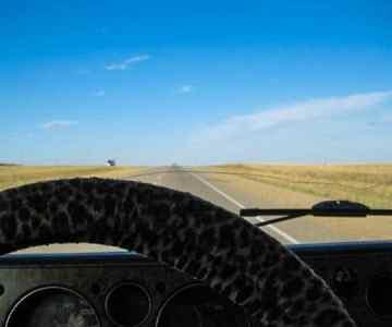 Never-ending horizon prairies Canada road trip.