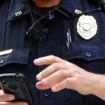 Officer Holding Cell Phone-PD