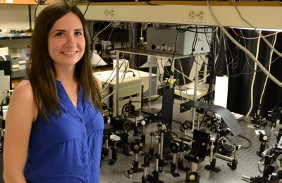 Bridget Salna, physics PhD student, stands in a lab