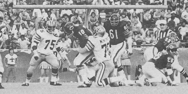 Billy Newsome of the 1973 New Orleans Saints sacks Bobby Douglas of Chicago