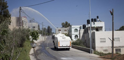 image of an Israel Defense Forces skunk weapon spraying West Bank houses.