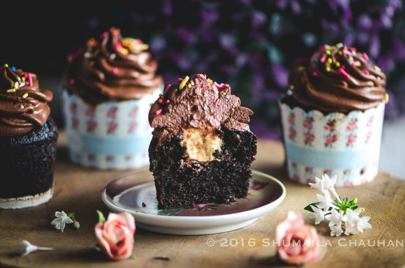 Peanut butter mousse filled chocolate cupcakes (eggless)