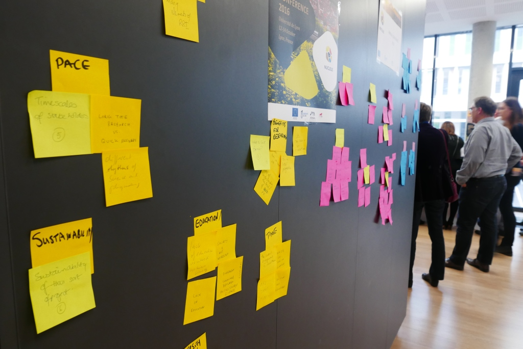 Reflections from conference participants on common themes across the field trip findings., collected on post-it notes.