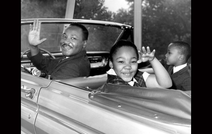 Rev Martin Luther King, Jr. waves with his children, Yolanda and Martin Luther III, while on Ford Motor Company's time-traveling journey designed by Disney at the World's Fair. Photo: Hulton Archive