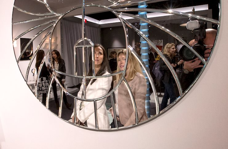 Visitors at the stand of Galerie Kreo during the preview for TEFAF New York Spring. Image courtesy TEFAF.