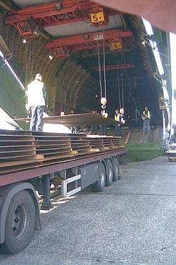 Steel plates being loaded onboard cargo plane as airfreight 250 x 375