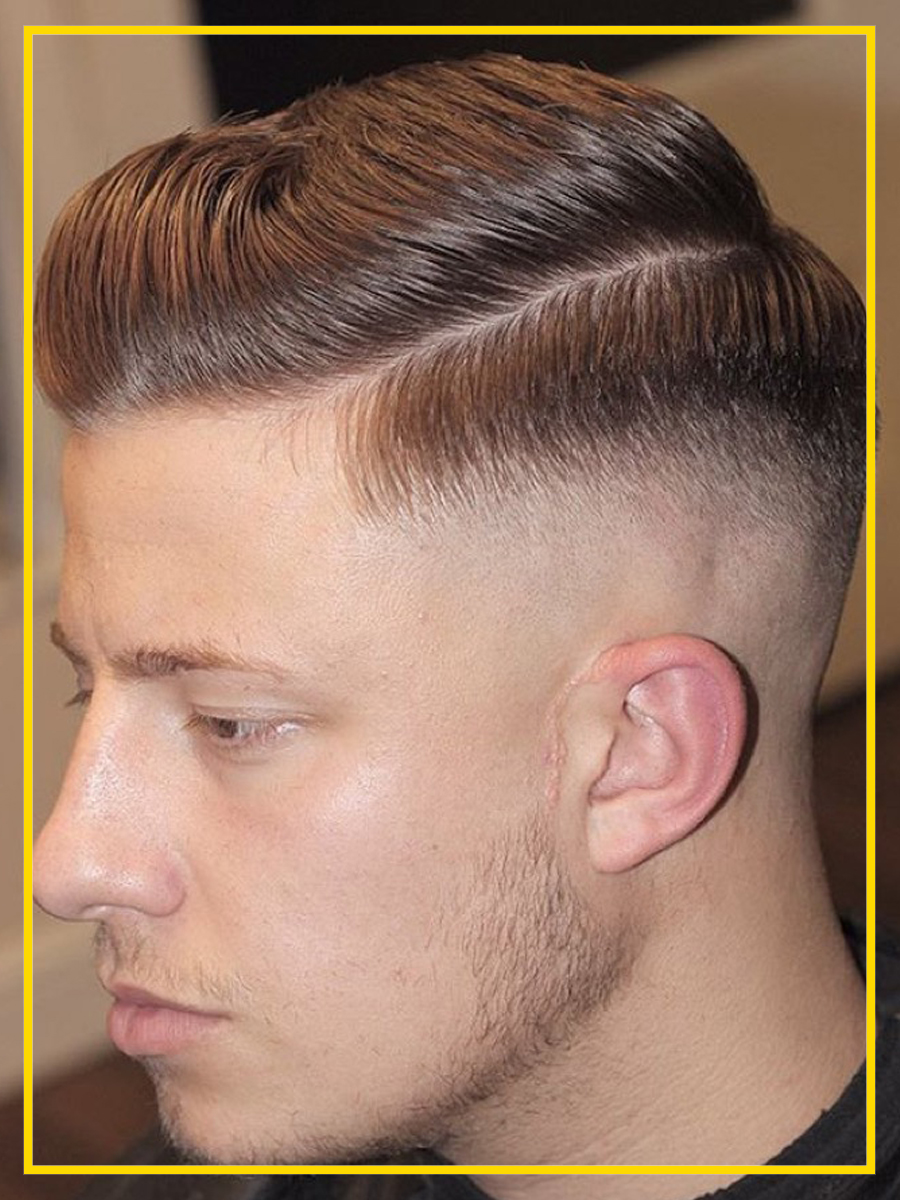 Mid Fade com penteado clássico masculino.