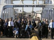 Obama participates in a march across the Edmund Pettus Bridge in Selma, Alabama