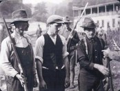 Miners from the Battle of Blair Mountain at the foot of Blair Mountain giving up their guns