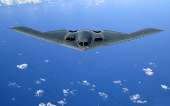 A B-2 Spirit soars after a refueling mission over the Pacific Ocean on Tuesday, May 30, 2006. The B-2, from the 509th Bomb Wing at Whiteman Air Force Base, Mo., is part of a continuous bomber presence in the Asia-Pacific region. (U.S. Air Force photo/Staff Sgt. Bennie J. Davis III)