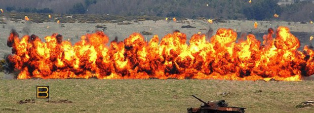 Multiple explosions as the British Python Minefield Breaching System clears a minefield.