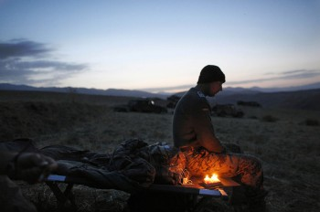 A German soldier sits next to candles lit to celebrate his 34th birthday, during a long term patrol in Yaftal e Sofla, in the mountainous region of Feyzabad, east of Kunduz, Afghanistan, on September 16, 2009. (AP Photo/Anja Niedringhaus)