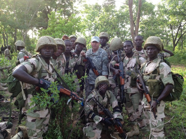 A California National Guard Special Forces soldier from Los Alamitos-based Special Operations Detachment–U.S. Northern Command and Company A, 5th Battalion, 19th Special Forces Group (Airborne), poses with Nigerian soldiers on May 31, 2014, during a training mission in Nigeria.