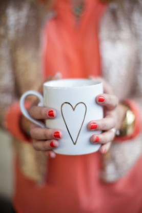 daily coffee in a pretty gold heart mug from west elm