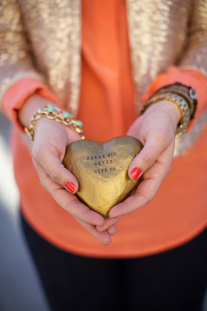 gold paper maché heart reading dream big, never give up. by paloma's nest on oh lovely day.