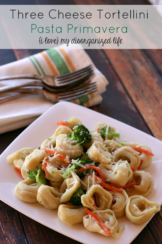 Three Cheese Tortellini Pasta Primavera- made with Asiago, Parmesan, Romano and fresh veggies, this dish is cheesy and ready in about 30 min!