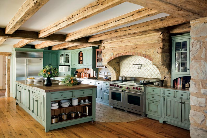 primitive colonial inspired kitchen colonial kitchen design The cabinets are finished in a distressed milk paint