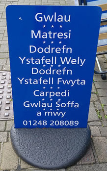 Welsh sign outside a furniture store in Bangor