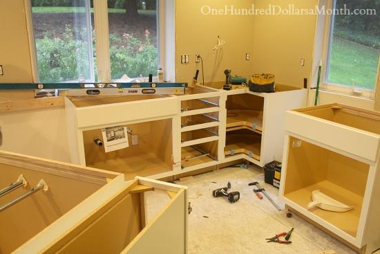 installing new white kitchen cabinets