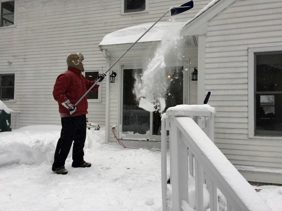 removing snow from the roof