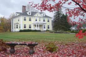 Governor's House in Hyde Park Vermont showing New England fall foliage on driving tour