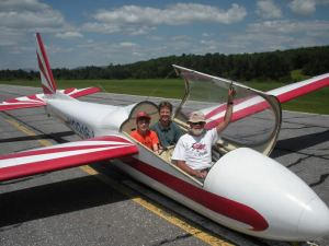 passengers smie from their seats after a glider ride