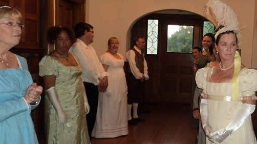 English country dancers in period dress waiting to begin