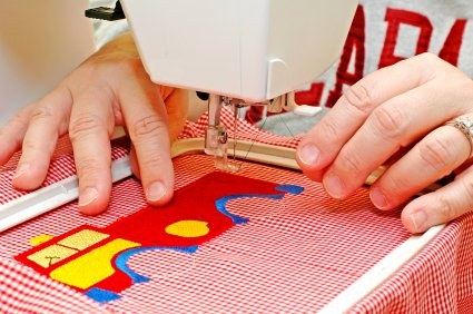 Like hand embroidery, machine embroidery is stretched in a hoop for ease of handling.