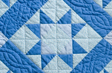 This classic star pattern has an added twist with the cable-like quilting stitch pattern which frames the main design.