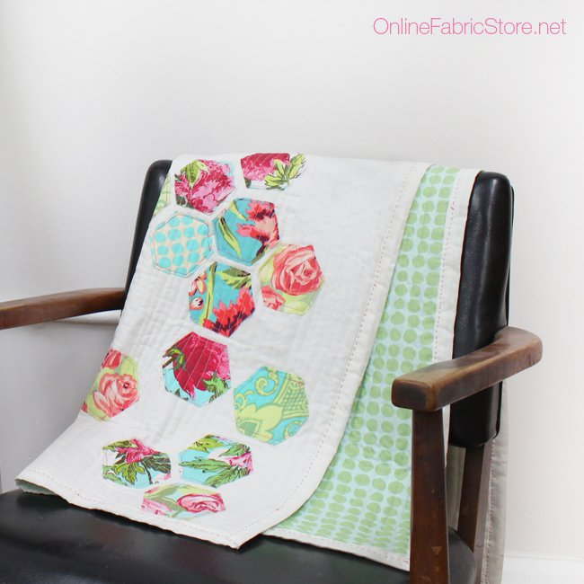 quilt on chairs