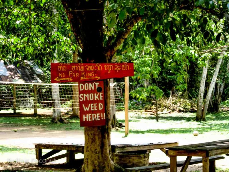 Sign at Golden Cave in Vang Vieng Laos Rolling Coconut Ooaworld Photo Ooaworld