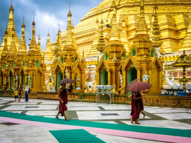 Monks Shwedagon Pagoda Yangon Myanmar ooaworld Rolling Coconut Photo Ooaworld