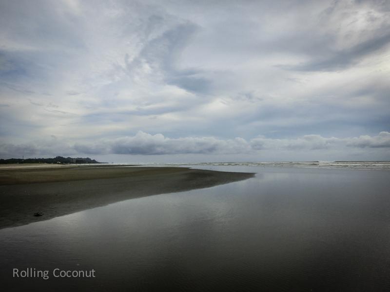 Bangladesh Cox Bazar Sand Strip on the Beach ooaworld Rolling Coconut Photo Ooaworld