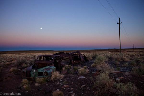 Car wreck near Meteor Crater at sunset, Arizona