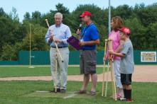 Rep. Mike Michaud presents the team with Maine-made walking sticks