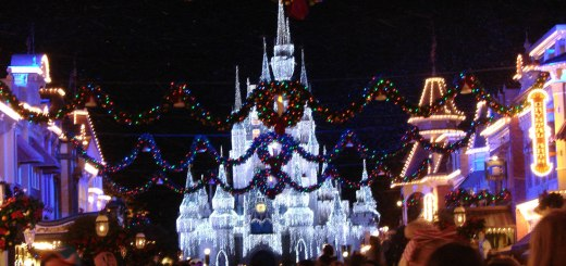 """Cinderella's castle gleams as Christmas music plays and """"snow falls along Main Street."""