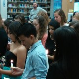 Inductees hold ceremonial candles, which were lit my the mother candle is kept, while reciting the Spanish Honor Society oath. The mother candle is kept for the duration of the clubs existence, always lighting the smaller candles at the induction.